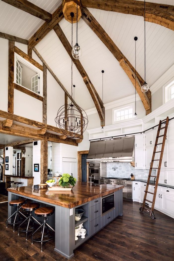 what does vaulted mean, wooden beams, wooden floor, kitchen island, wooden ladder, white walls