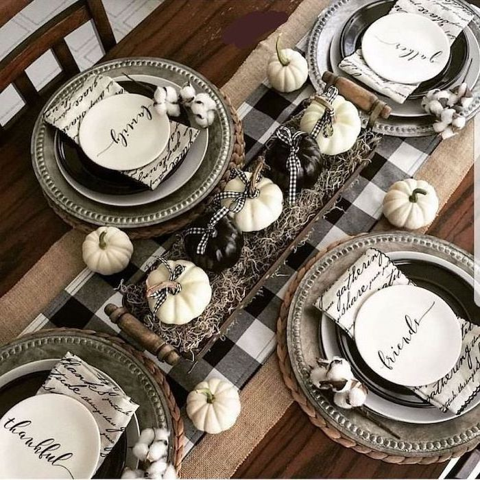 plate settings, white and black table runner, turkey decorations for thanksgiving, black and white pumpkin, in a wooden crate