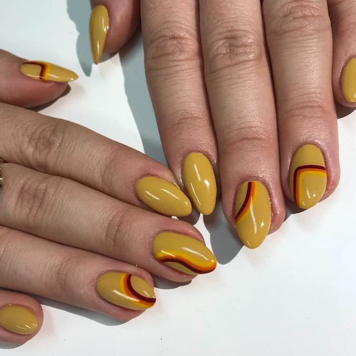 yellow nail polish, almond nails, september nail colors, yellow orange and red lines, nail decorations