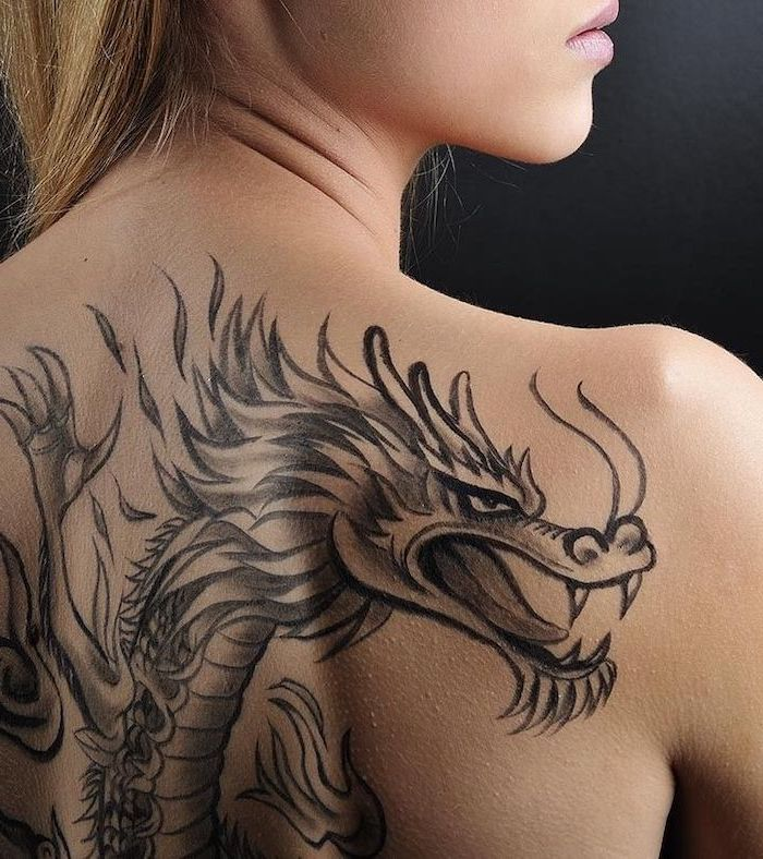large back tattoo, on woman with blonde hair, dragon tattoo, black background
