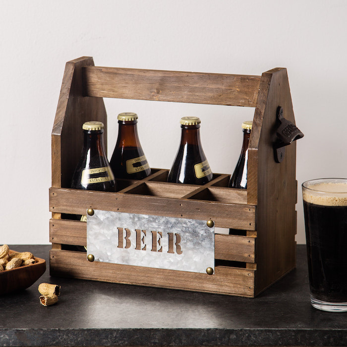 wooden beer caddy, made of wood and holding up to six bottles, gift ideas for men, placed on black granite surface