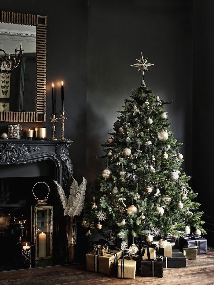 green faux tree decorated with gold and silver ornaments, presents underneath wrapped in gold and black paper, how to decorate a christmas tree