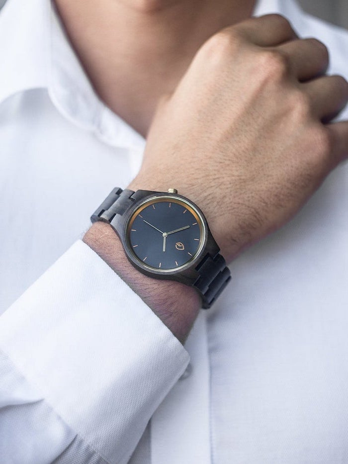 man wearing a white shirt, watch with black straps on the wrist, gift ideas for men