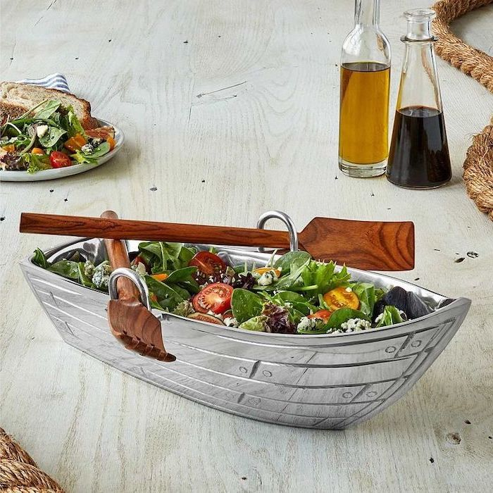 boat shaped salad bowl, with two wooden spatulas on the side, gifts for mom from daughter, placed on wooden table