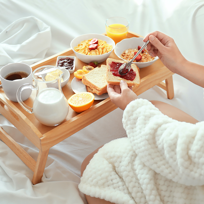 gifts for mom from daughter, wooden breakfast serving tray, breakfast in bed, woman wearing white cozy robe