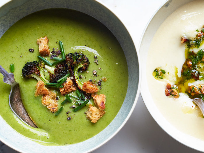 broccoli soup with croutons, baked broccoli on top for garnish, in ceramic bowls, chicken tortellini soup