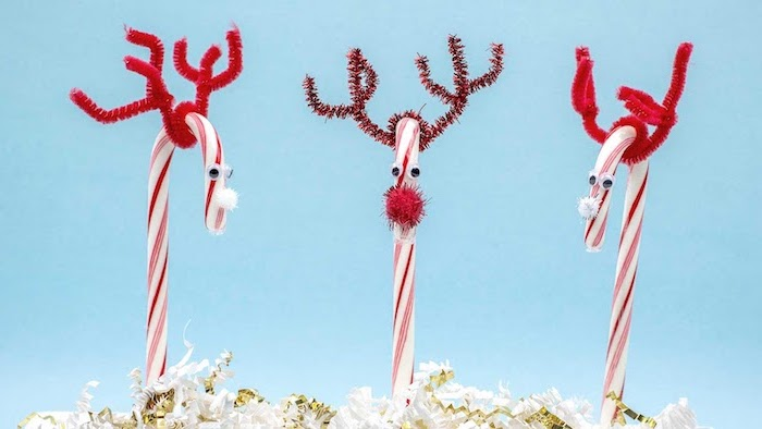 three candy canes, turned into reindeer, christmas crafts for toddlers age 2 3, blue background