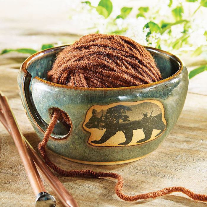 blue ceramic yarn bowl, with a bear picture on the side, brown yarn inside, christmas gifts for mom, needles on the side