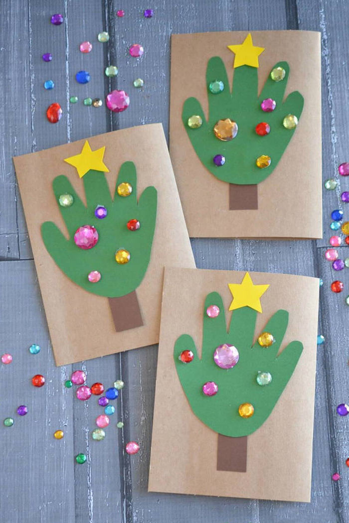 three christmas cards with handprints, cut out of green paper, christmas crafts for toddlers age 2 3, rhinestones on them