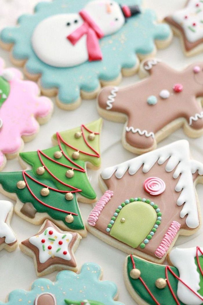 cookie decorating icing, cookies in different shapes, decorated with colorful icing, arranged on white surface