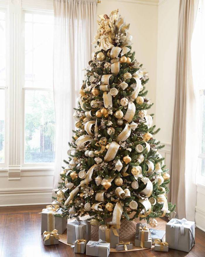 christmas tree decorating ideas, gold ribbon and gold and silver ornaments, on a tall tree with wrapped presents underneath