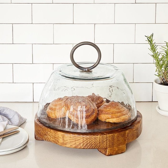 serving board made of salvage wood, large glass lid with metal ring, cinnamon buns inside, christmas gifts for mom