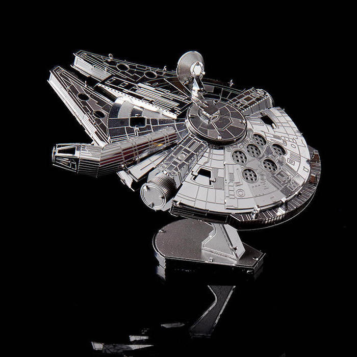 milenium falcon 3d metal puzzle, cute gifts for boyfriend, placed on black surface, black background