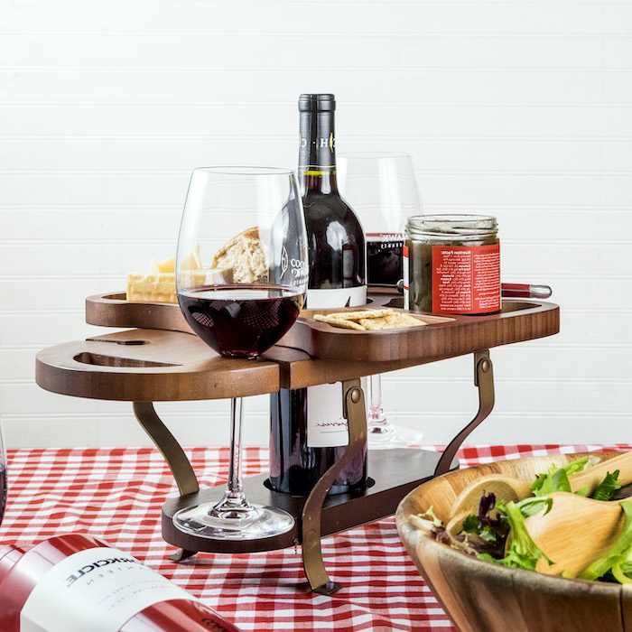 wooden wine caddy, spaces for bottle glasses and cheese and crackers, christmas gifts for mom, placed on the table