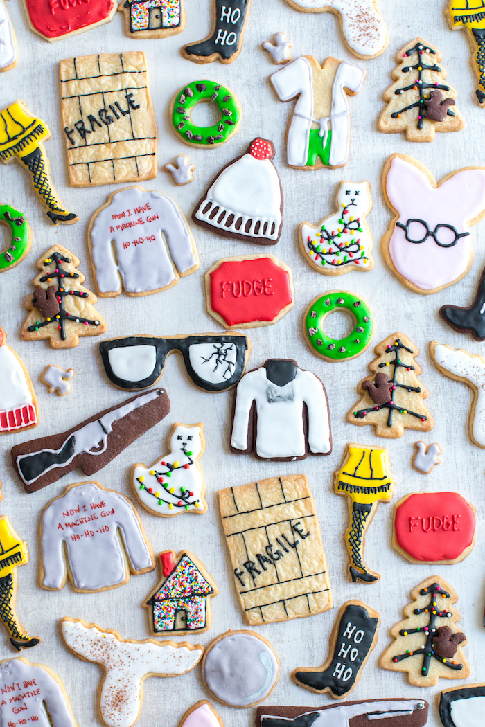 different shaped cookies, placed on white surface, cookie icing, different icing decorations on each cookie