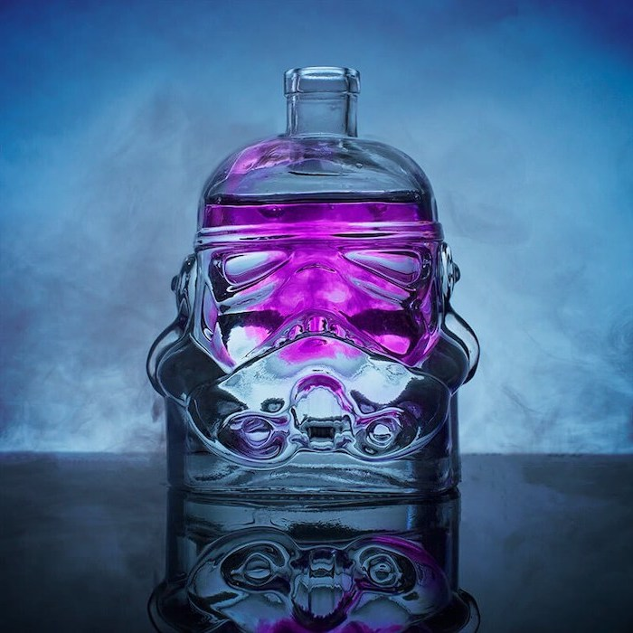 star wars inspired stormtrooper decanter, filled with purple liquid, christmas gifts for men, placed on black surface