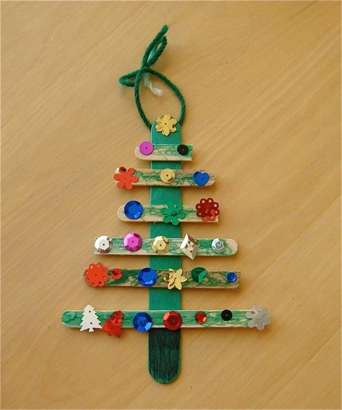 christmas tree made of popsicle sticks, painted in green, christmas ornaments for kids, colorful rhinestones glued to them