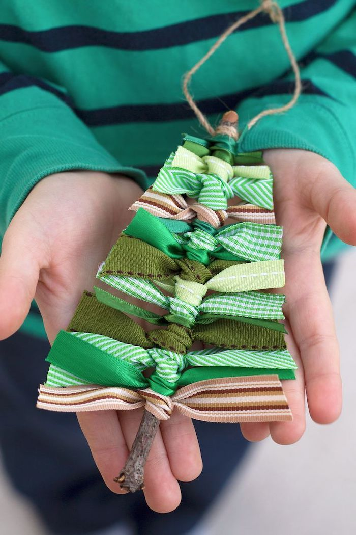 christmas tree ornament, made with a twig and ribbons with different patterns, christmas arts and crafts