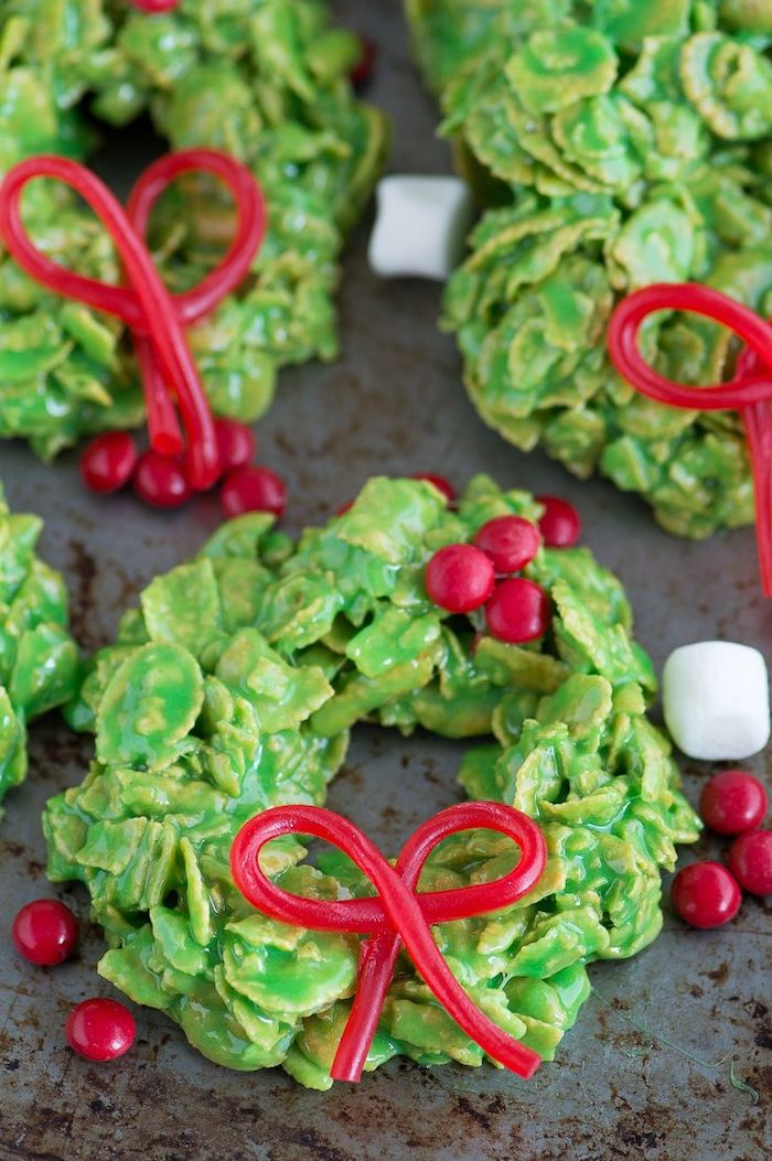 no bake cookies, decorated sugar cookies, wreath shaped cookies, made with oatmeal, placed on grey surface