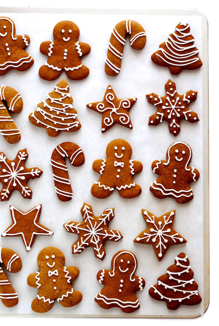 gingerbread cookies in different shapes, cookie icing, gingerbread men and women, snowflakes and candy canes