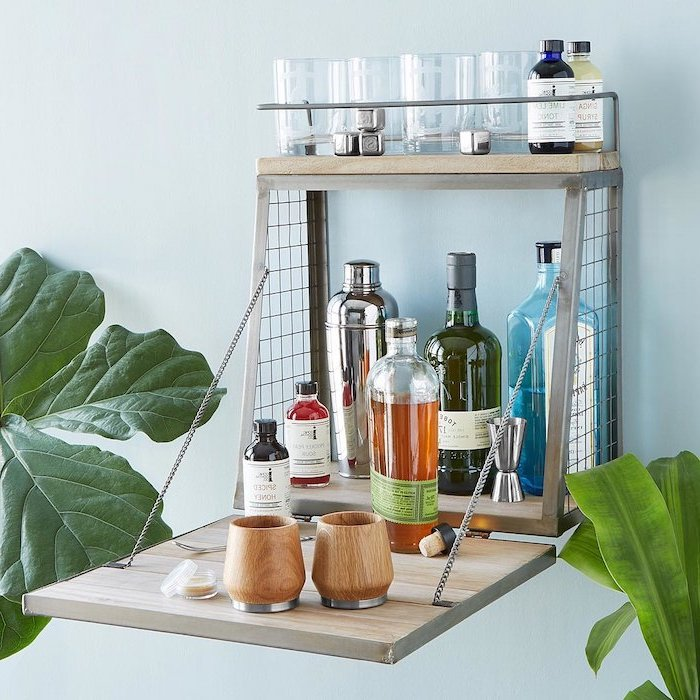 wall mounted wooden cocktail bar, what to get your mom for christmas, bottles of alcohol and glasses inside