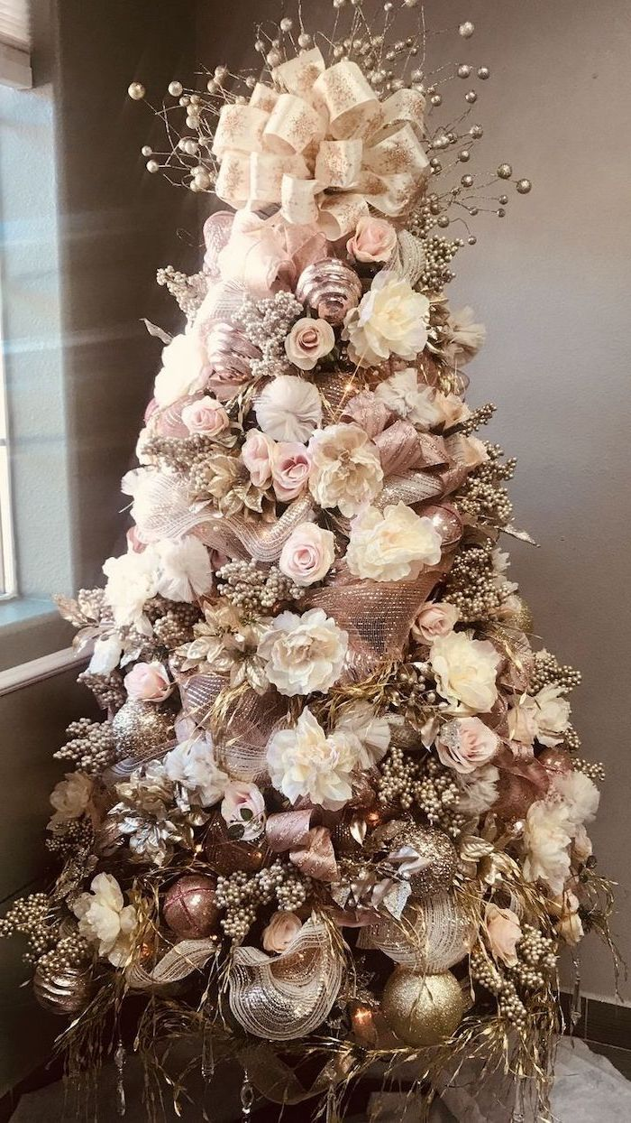 christmas tree ribbon, decorated with faux roses and flowers, rose gold ornaments and ribbons, large bow on top