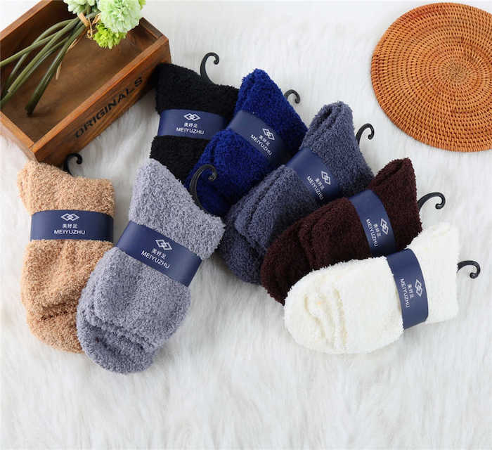 lots of pairs of cozy socks in different colors, what to get your boyfriend for christmas, wooden box with flowers inside