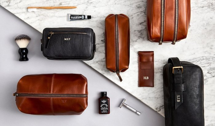 christmas gifts for boyfriend, personalised brown and black leather pouches, shaving tools arranged around them