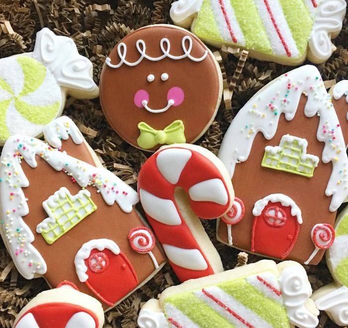 cookies in different shapes, decorated with colorful icing, placed on crepe paper, how to decorate sugar cookies
