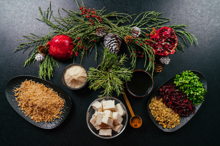 different ingredients in different plates and bowls, arranged on black surface, cream cheese christmas appetizers