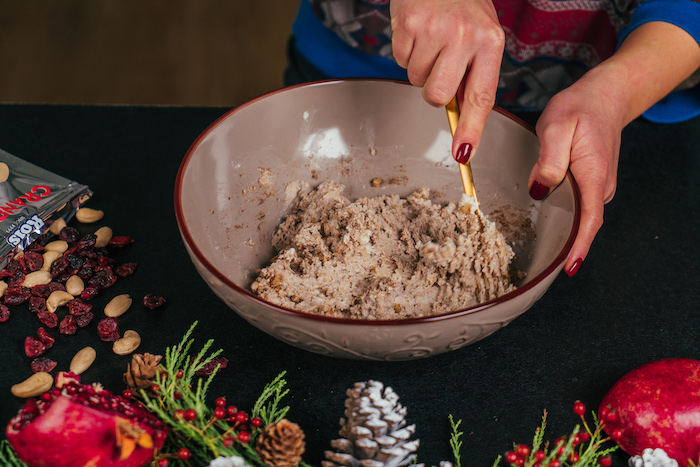 different ingredients mixed in ceramic bowl, cream cheese christmas appetizers, placed on black surface