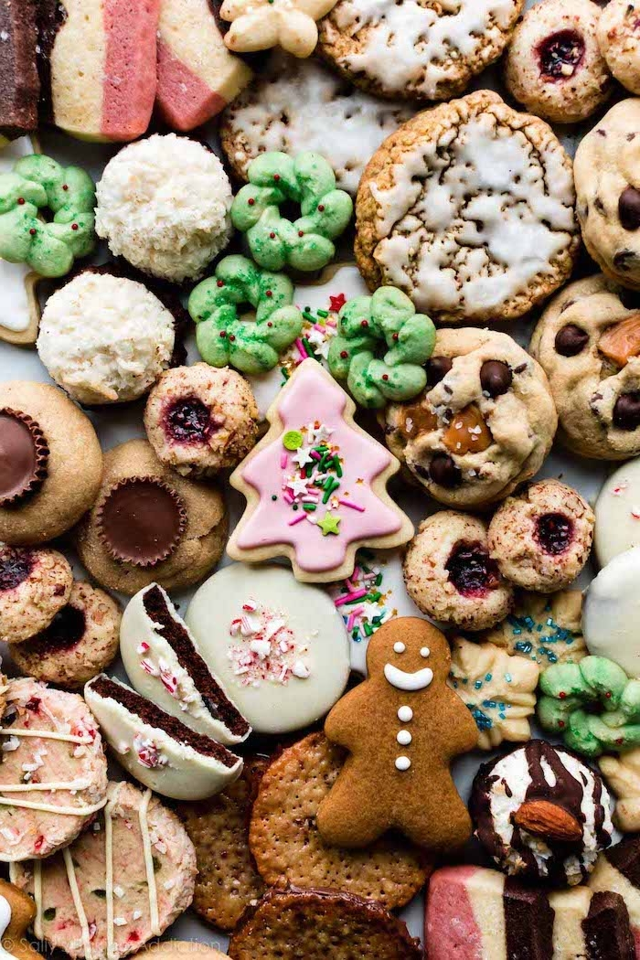 lots of different cookies, with different icing and decorations, how to decorate sugar cookies, all placed on white surface