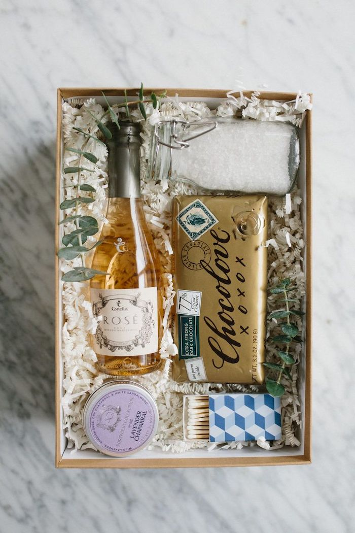 carton box full of chocolate rose and bath salts, christmas gift ideas for mom, bubble bath gift set, marble countertop