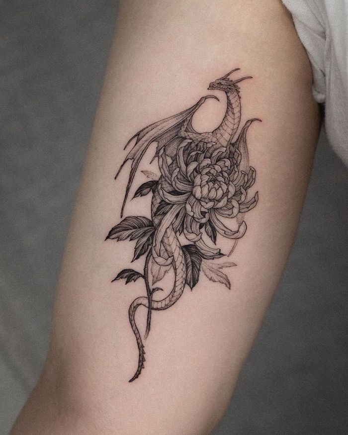 dragon holding flowers, inside arm tattoo, japanese tattoo meanings, grey background