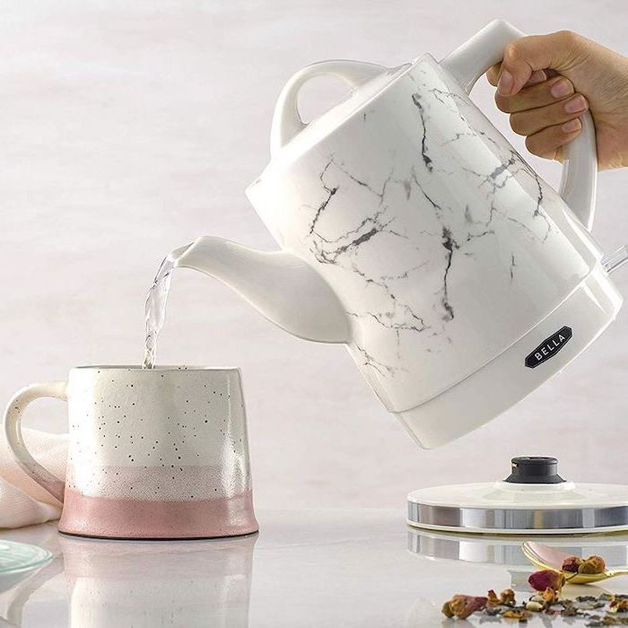 electric tea kettle with marble print, what to get your mom for christmas, pouring water in a ceramic mug