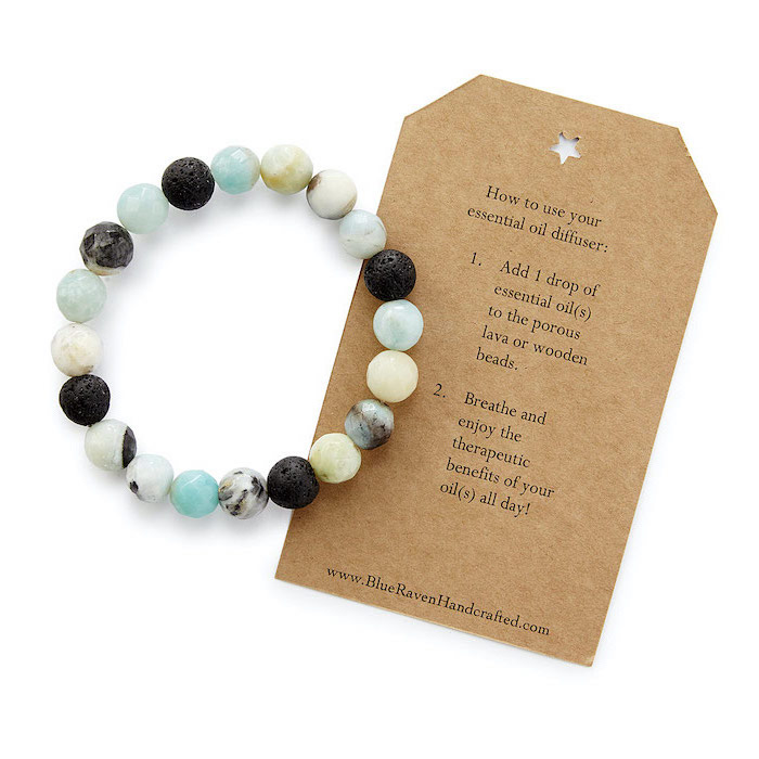 essential oil diffusing bracelet, card with the instructions on the side, white background, what to get your mom for christmas