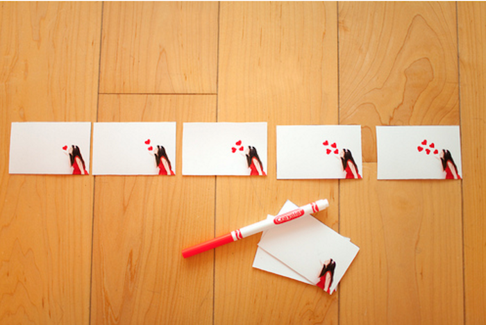 flip book pages, girl blowing kisses in the corner, placed on wooden surface, christmas gifts for men