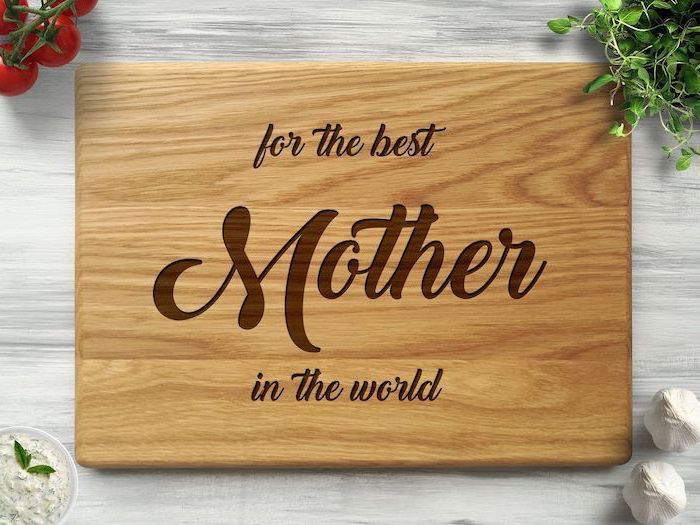 for the best mother in the world, carved wooden cutting board, christmas gift ideas for mom, placed on white wooden table