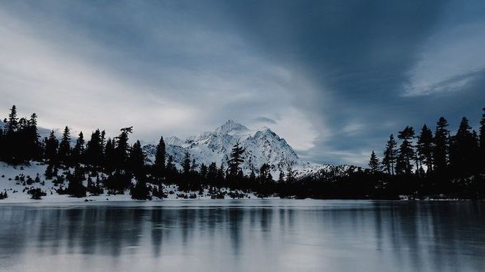 winter desktop backgrounds, mountain landscape, lake surrounded by tall trees, mountain peak covered with snow