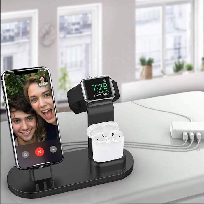 black charging station, iphone watch and air pods charging on it, what to get your boyfriend for christmas, placed on white surface