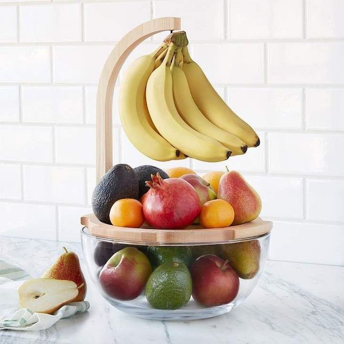 fruit bowl made of glass and wood, full of fruits, christmas gifts for mothers, placed on marble countertop