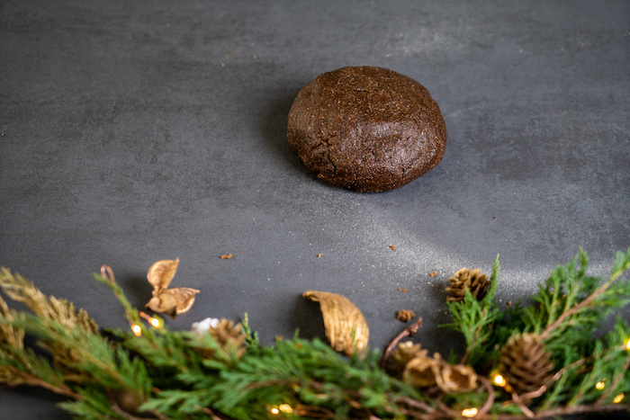 gingerbread cookies dough, placed on lightly floured black surface, decorating gingerbread cookies