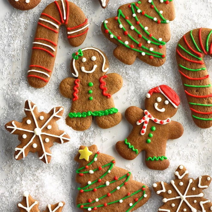 gingerbread men and women, christmas trees and candy canes, snowflake gingerbread cookies, cookie icing
