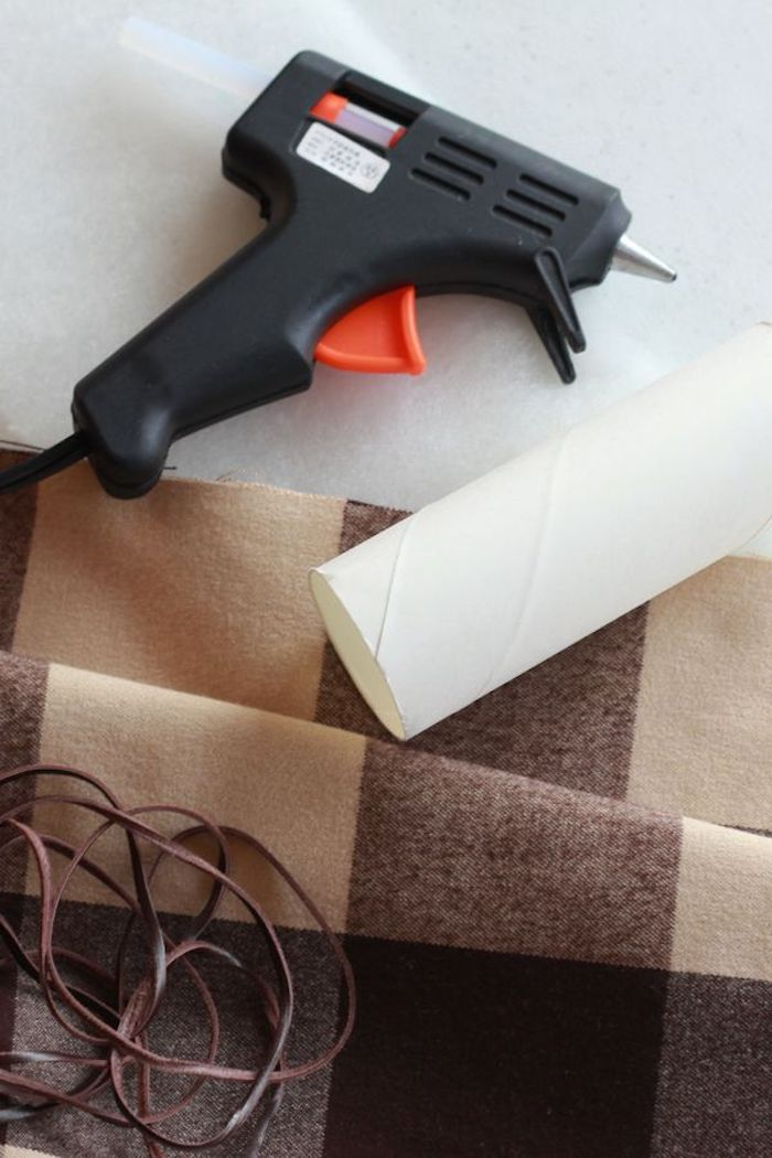 glue gun and carton from toilet paper roll, plaid cloth and brown leather straps, gift ideas for boyfriend, step by step diy tutorial