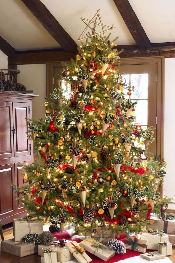 large tree decorated with red ribbon, paper cones with flowers inside, colorful christmas tree, presents underneath