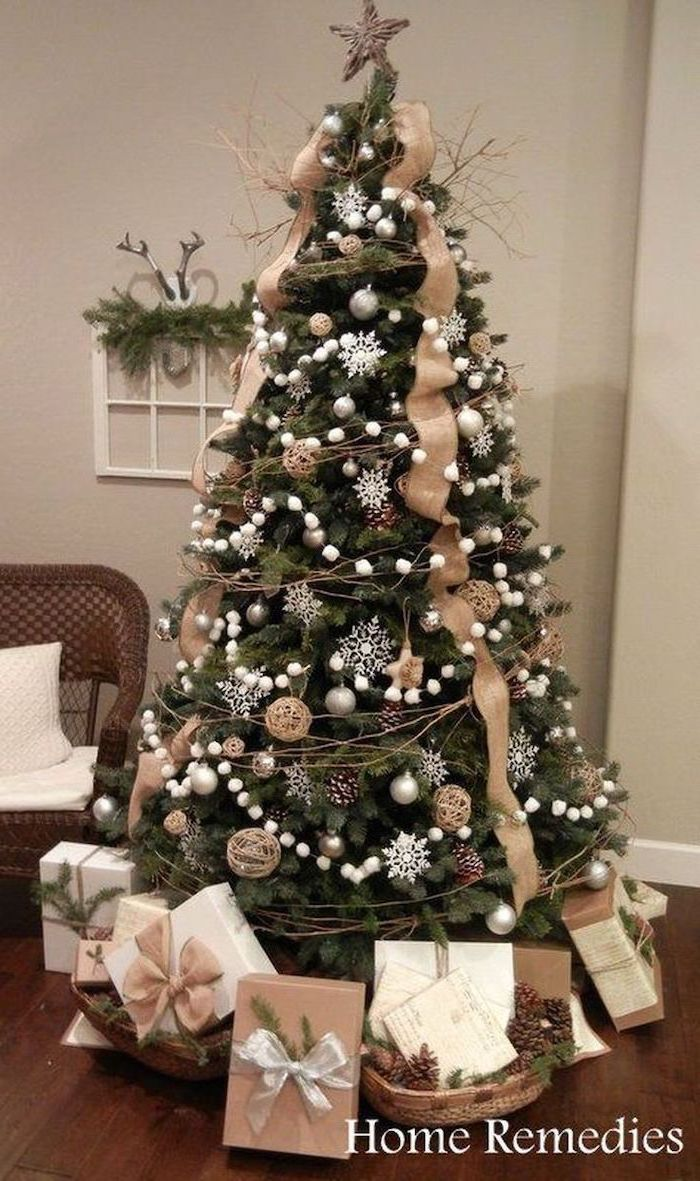 tree decorated with gold ribbon, gold ornaments and white snowflakes, rustic christmas tree, wrapped presents underneath
