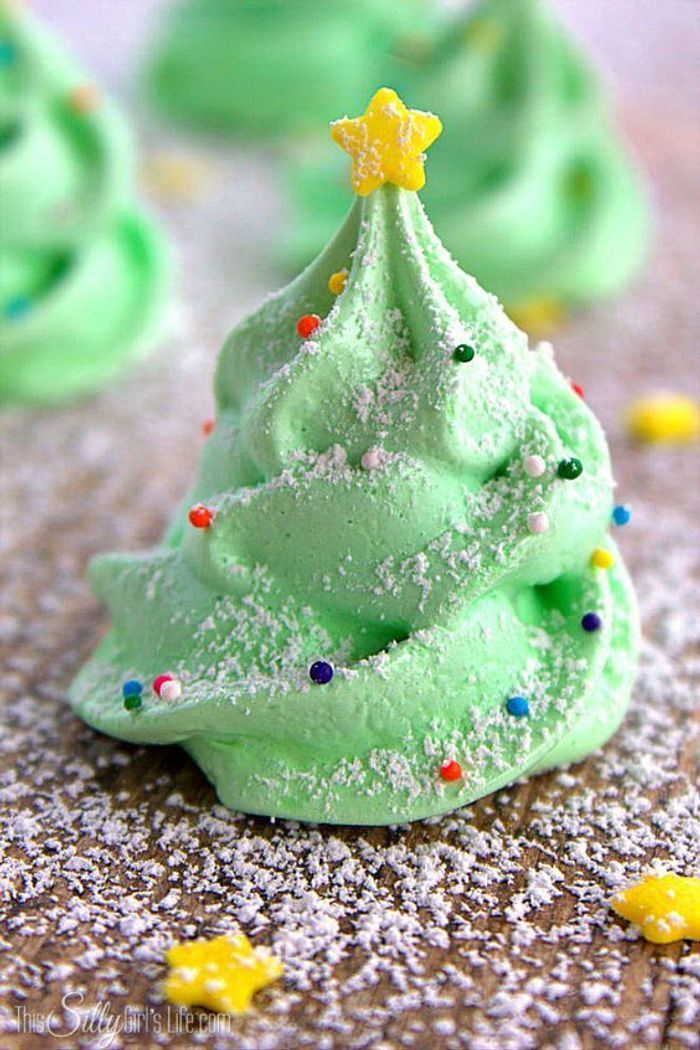 green meringue cookies, in the shape of a christmas tree, gold star on top, how to make icing for cookies, covered with powdered sugar