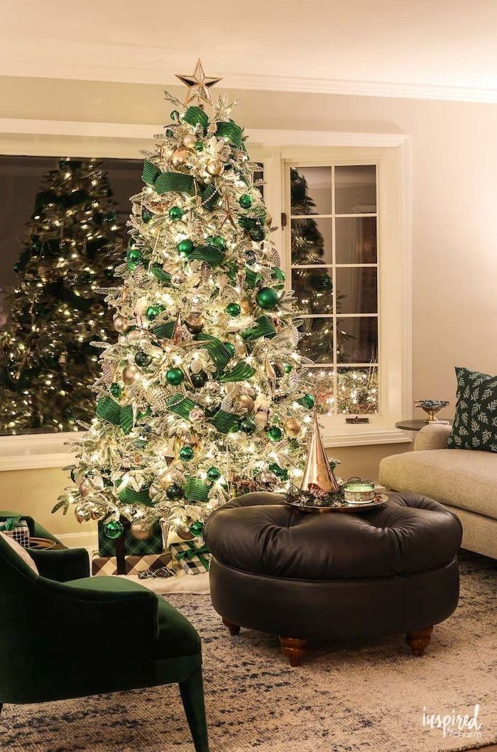 tree decorated with lots of lights, green ornaments and ribbon, how to put ribbon on a christmas tree, gold star on top