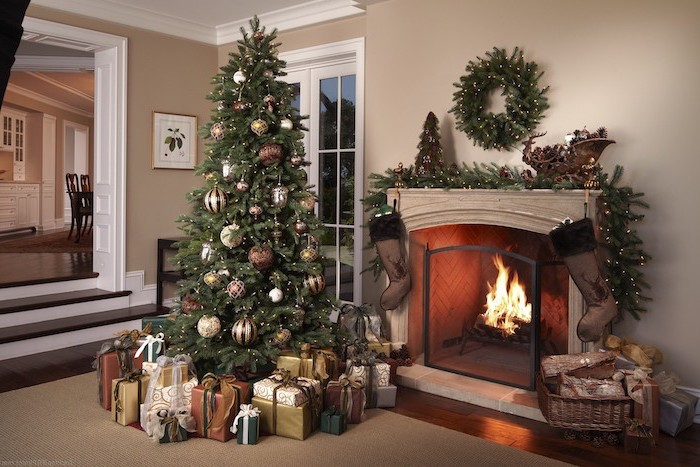 tree next to a fireplace, surrounded by wrapped presents, decorated with red and gold ornaments, how to put ribbon on a christmas tree
