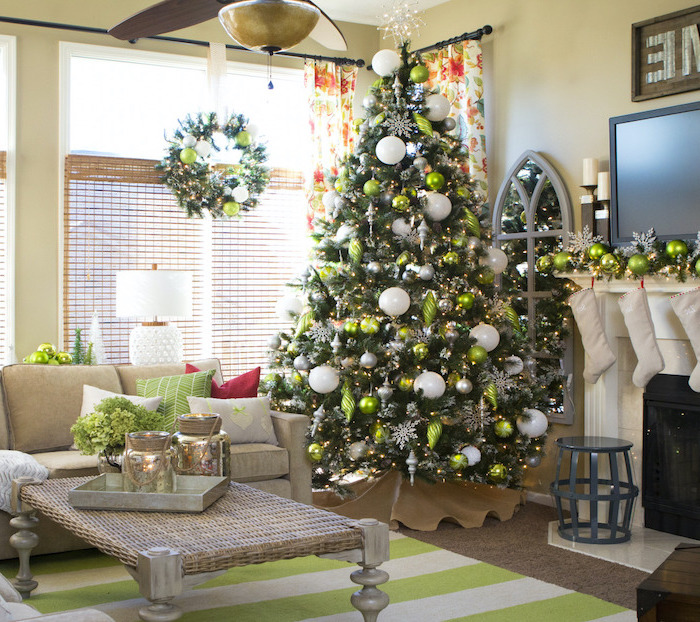 tree placed in the corner, decorated with white silver and green ornaments, rustic christmas tree, placed on wooden floor